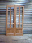 Pair of oak internal doors with raised and fielded panels