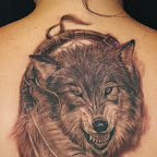 wolf with two Indian feathers - tattoos for men
