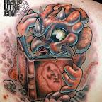 pt00276-Travis Litke Dinosaur Book Origin of Species Charles Darwin Valparaiso Tattoos Indiana.jpg