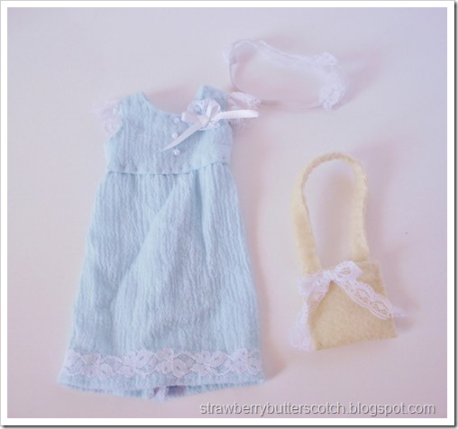 Blue doll dress with a lace headband and a bag.