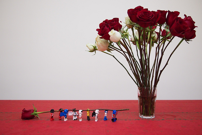 Autobot Kreons carrying a rose to the vase