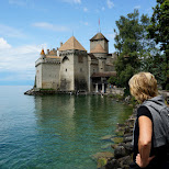 my mom observing Chillon Castle in Switzerland in Veytaux, Vaud, Switzerland