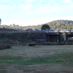 View of highway and bridge from the upper Yarrangobilly Village camping area