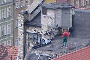 Polish workers on a roof.
