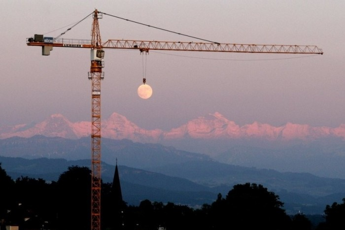 Crane Lifting A Moon