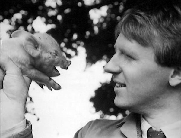 Peter Davison and a piglet