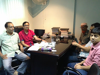 With board members in Bangladesh