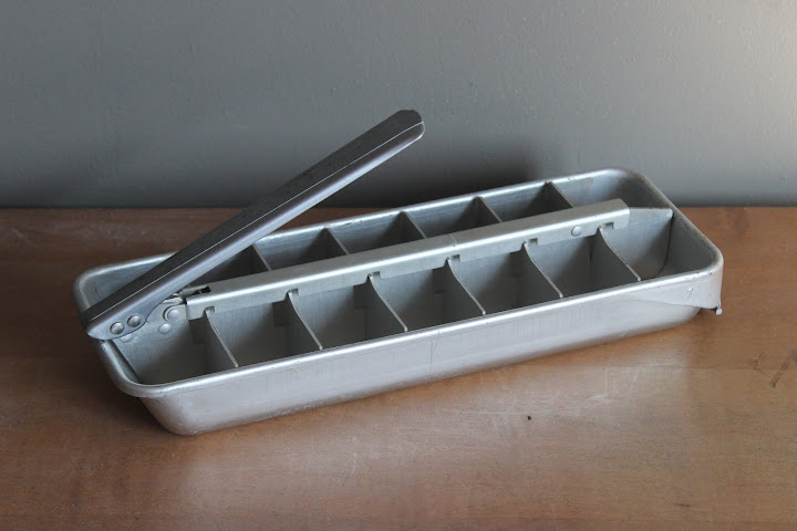 Metal ice cube tray available for rent from www.momentarilyyours.com, $15.00.