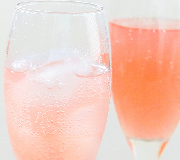 close-up photo of two champagne glasses