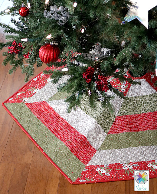 Holly Jolly Tree Skirt pattern - has three sizes and Jelly Roll instructions - pattern by Andy Knowlton of A Bright Corner