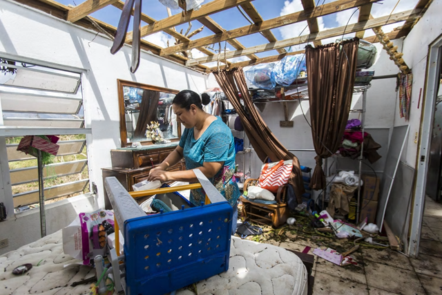 Meryanne Aldea lost everything at her house when the winds of Hurricane Maria ripped away the roof. The mountain town of Juncos is one of the most affected areas in Puerto Rico, and it remains largely isolated from the rest of the island — and the world. Photo: DENNIS M. Rivera Pichardo / The Washington Post