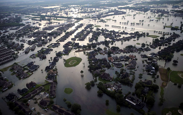 Aerial view of floodwaters from Tropical Storm Harvey surrounding homes in Port Arthur, Texas, Thursday, 31 August 2017. Photo: Gerald Herbert / AP Photo