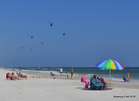 Helicopters flying over the beach