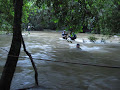 The Paku crossing, normally an easy paddle, not after heavy rain | photo © Andy Eavis