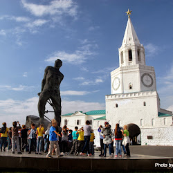 Children frolic around a statue of Tatar poet and freedom fighter Mulla Jalil in front of the Spasskaya Tower, entrance to the Kazan Kremlin