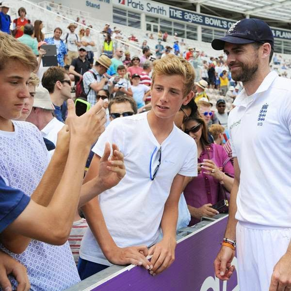 England's James Anderson (R) poses for a picture with fans after winning the third cricket Test match between England and India at The Aegeas Bowl cricket ground, in Southampton, England, on July 31, 2014.