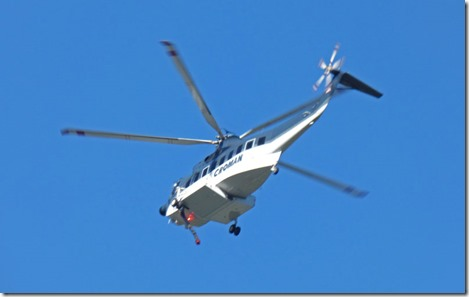 Lobster Creek Fire -- helicopter headed to fire over Huntley Park near Gold Beach