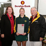 Mary at Doncaster Hockey Club presenting Sam Snow with the player of the match award