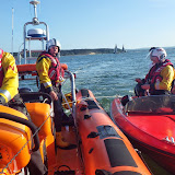 Trainee Helm Rob Inett being put through his paces as Poole ILB crew place a broken down speedboat in an alongside tow after it was picked up next to Poole Lifeboat Station 12 June 2014 Photo: RNLI Poole