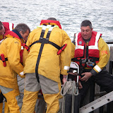 20 April 2012 - Poole inshore and all-weather lifeboat crew help unload firefighting equipment on Green Island. Photo: RNLI/Poole Lifeboat Station Anne Millman