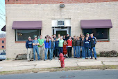 Some of our Reality staff, leaders & committee in front of our NEW office on Morris Street in Downtown Durhm