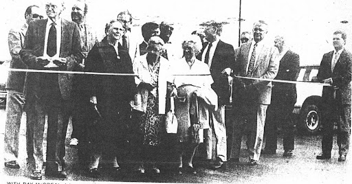 Opening of the Chatsworth-Melvin Blacktop 1988 Front row by rope: Ray McGreal, Mrs. Harold Hoppler, Nellie Ruppel, Katherine Ruppel, Rep. Tom Ewing, Burnell Watson, Tom Livingston.