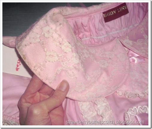 The before photo for the slightly ugly pink Bodyline dress.  Close up of the collar with discoloration.
