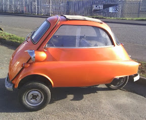 tangerine orange 3 wheel smart car