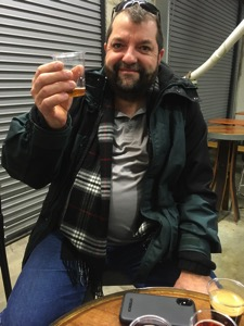 Neal sampling beer at DC Brau