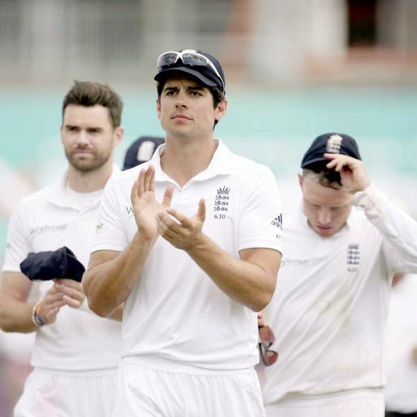 England captain Alastair Cook, center, applauds as he walks off the field of play with man-of-the-match James Anderson, background left, and Ian Bell, background right, after defeating India on the fifth and final day of the third cricket test match of the series between England and India at The Ageas Bowl, in Southampton, England, Thursday, on July 31, 2014.