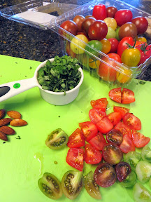 Almonds, Basil, and Colorful Grape Tomatoes for a Corn Ravioli Recipe
