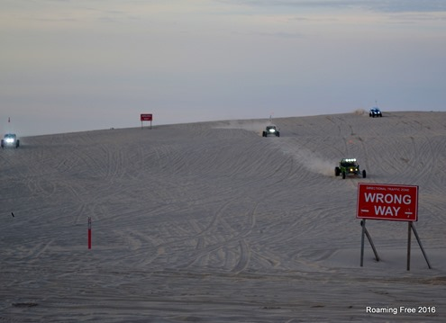 Sandrails racing over the dunes