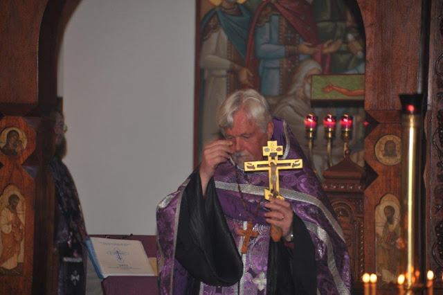 Fr. Joseph Woodill blesses the faithful with the hand-cross.