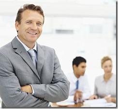 Happy senior business man making his notes at work