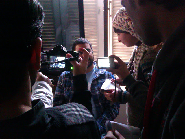 Alaa surrounded by media