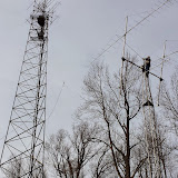 VHF, UHF microwave free standing tower (left), Terry W8ZN on 2m EME tower installing triband FM vertical pre-contest.