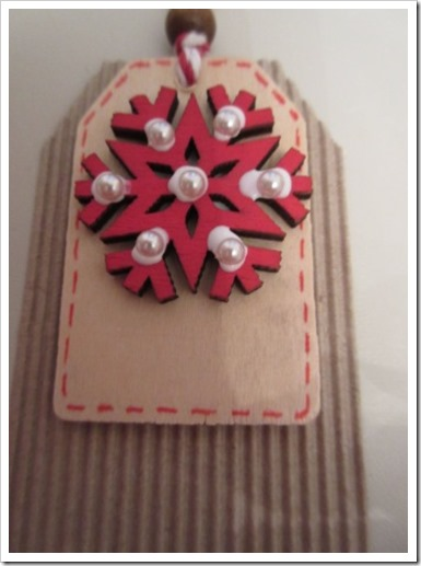 Red snowflake tag, globs of glue