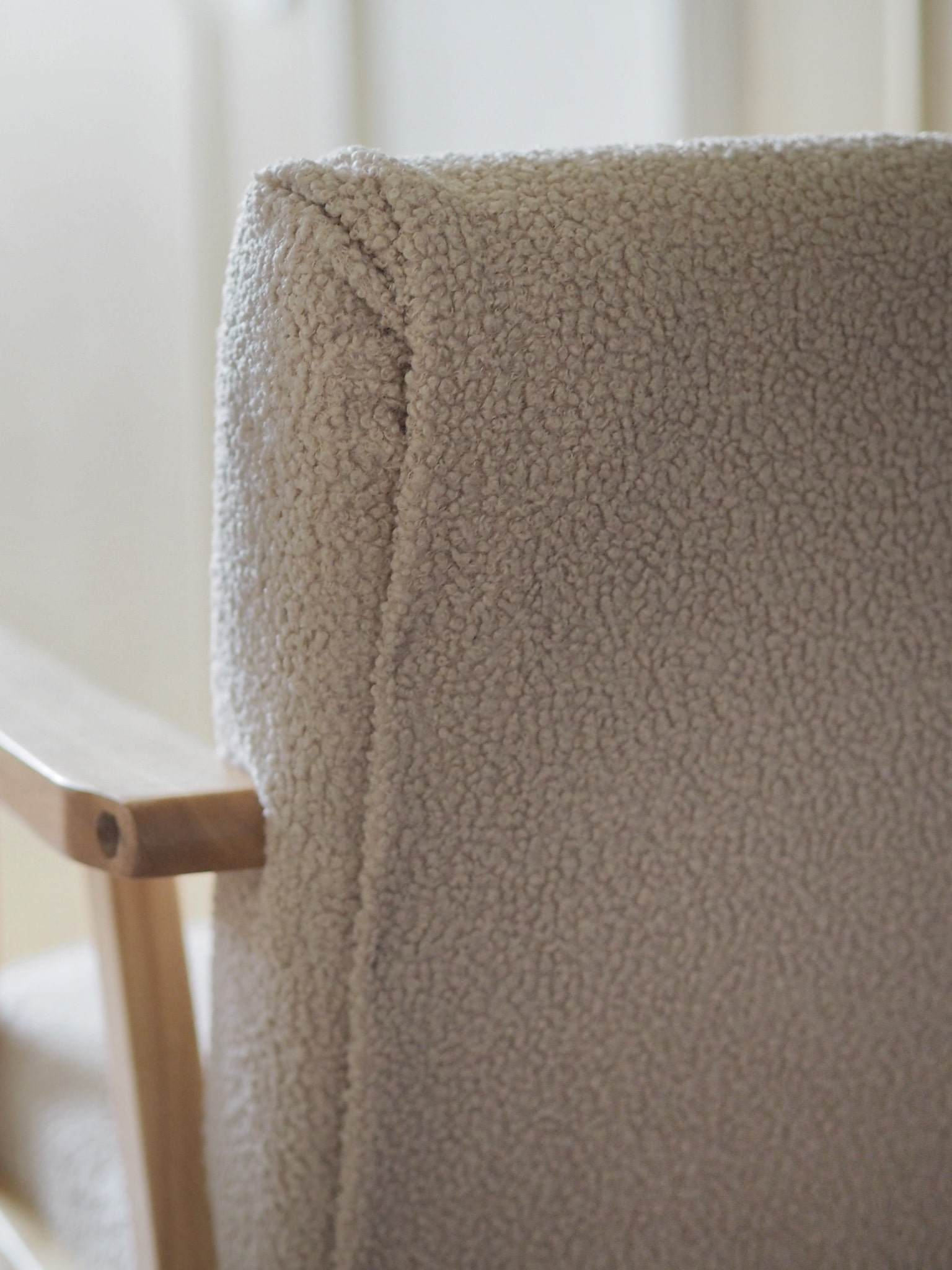 How to upholster an armchair scandi style with boucle fabric, no sew. Use a staple gun and velcro tape to upcycle a chair into a luxury style