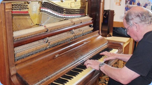 Joe Fingers preferred to play the 'beat-up' piano belonging to the Bowling Club rather than the Club's Clavinova! He certainly blasted-out the cob-webs! Photo courtesy of Dennis Lyons.