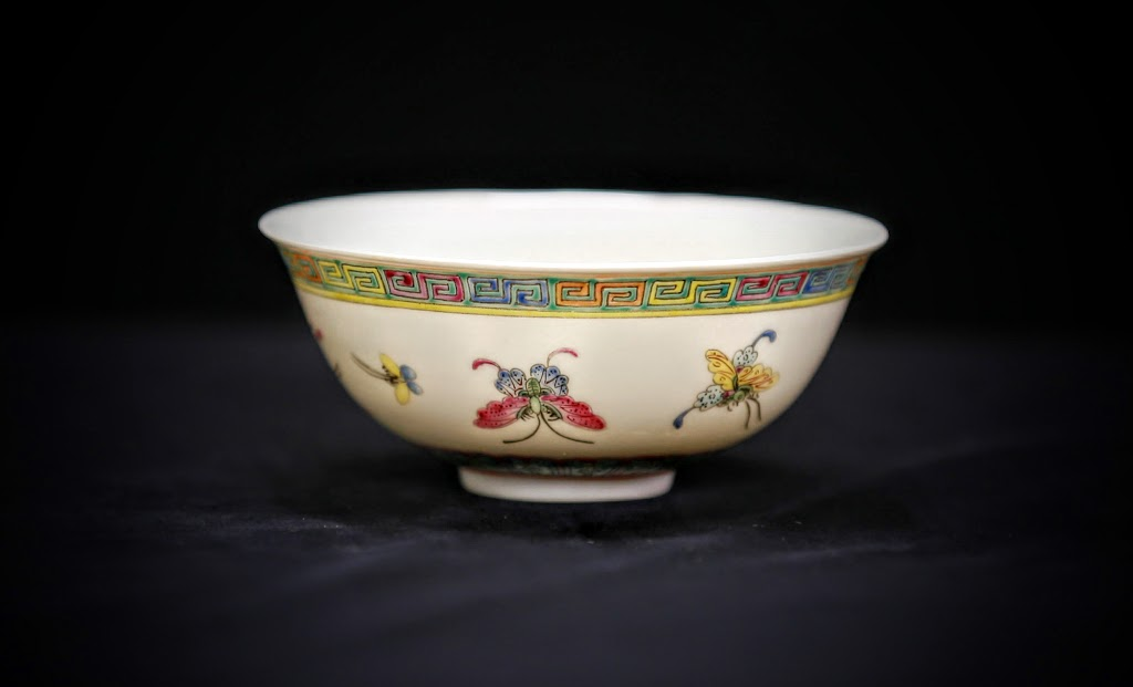 6.	彩蝶粉彩碗 乾隆款  Lot 6 – Chinese Famille Rose Butterfly Bowl China, 19th Century, Famille Rose bowl with images of butterflies. Bottom of the bowl bears the six-character QianLong mark. Height 2 in., Diameter 4.5 in.