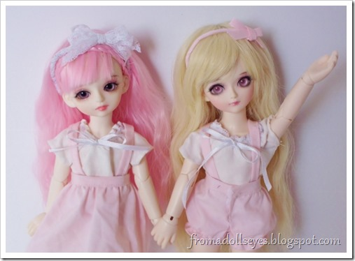 Two yosd sized ball jointed dolls.  One quiet one with pink hair (Yuna) and one noisy one with blond hair (Sakura).  They are excited to start making their Halloween costumes.