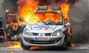 french police car set afire by immigrants