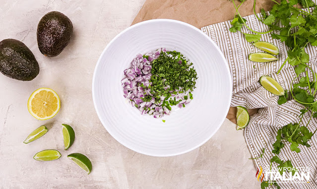 Chipotle guacamole onions and herbs in bowl