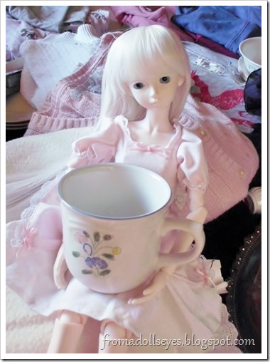 "Wordless Wednesday: ""This Is Not the Right Size"":  A ball jointed doll holding a large tea cup."