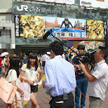 Japanese girls being interviewed at Shibuya station in Shibuya, Tokyo, Japan