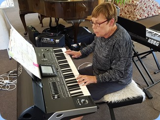 Yvonne Flemming playing her Korg Pa3X.