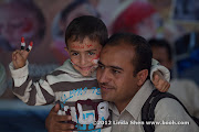 AFP photographer Mohammed Huwais and his son Abdullah. The Change Square, Sana'a, Yemen.  ساحة التغيير بصنعاء اليمن