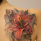 lily and butterfly in same tattoo - Shoulder Blade Tattoos Designs