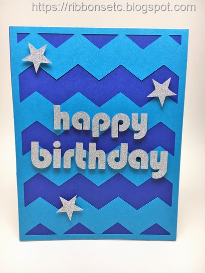 Happy birthday card with blue chevron background and the sentiment in silver glitter paper, with three stars