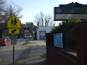Front sidewalk of church, southbound on Gregson, welcome sign to downtown Durham, crosswalk to DSA